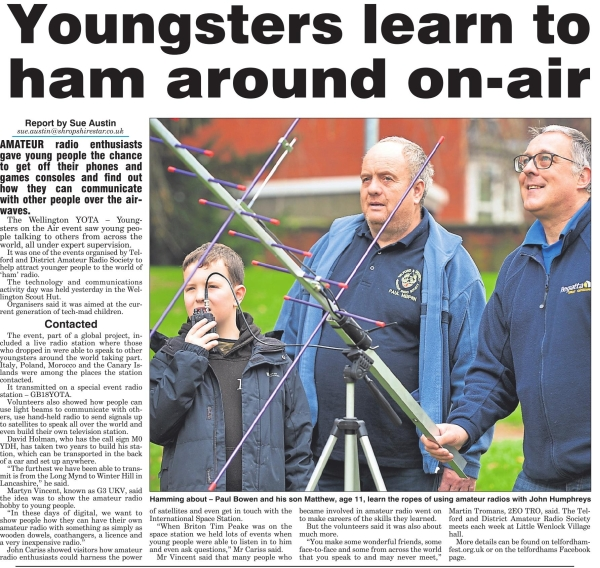 Members of TDARS running a Youngersters on the Air event (YOTA) help a young radio amateur use a satellite to communicate long distance