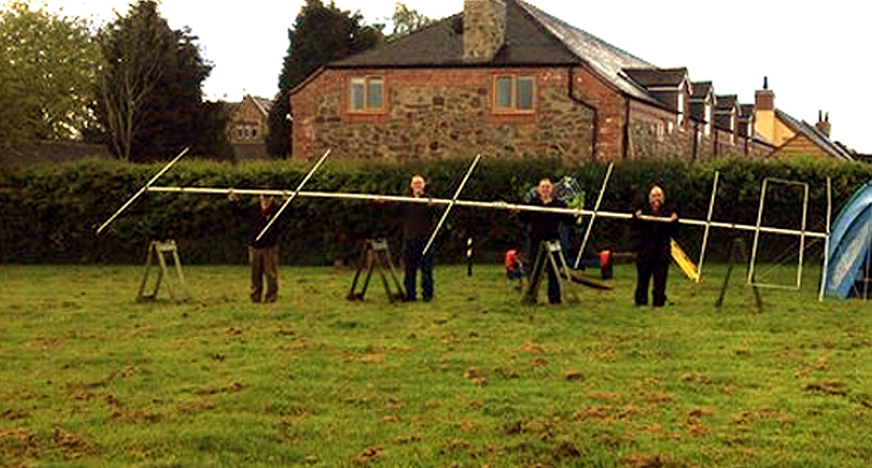 TDARS members pose with the 6m beam on the village field